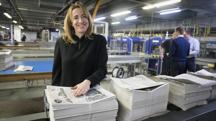 Guardian editor-in-chief Katharine Viner holds the first edition of the new tabloid Guardian at its new printing site, Trinity Mirror Printing in Watford.