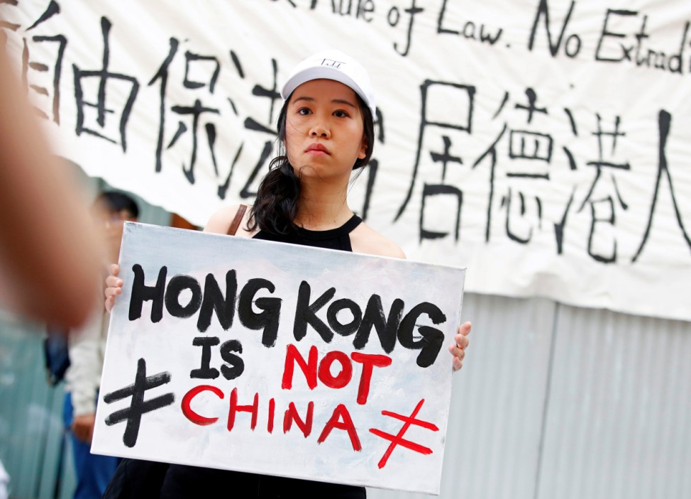 People attend a protest against proposed extradition bill of Hong Kong with China, in Berlin