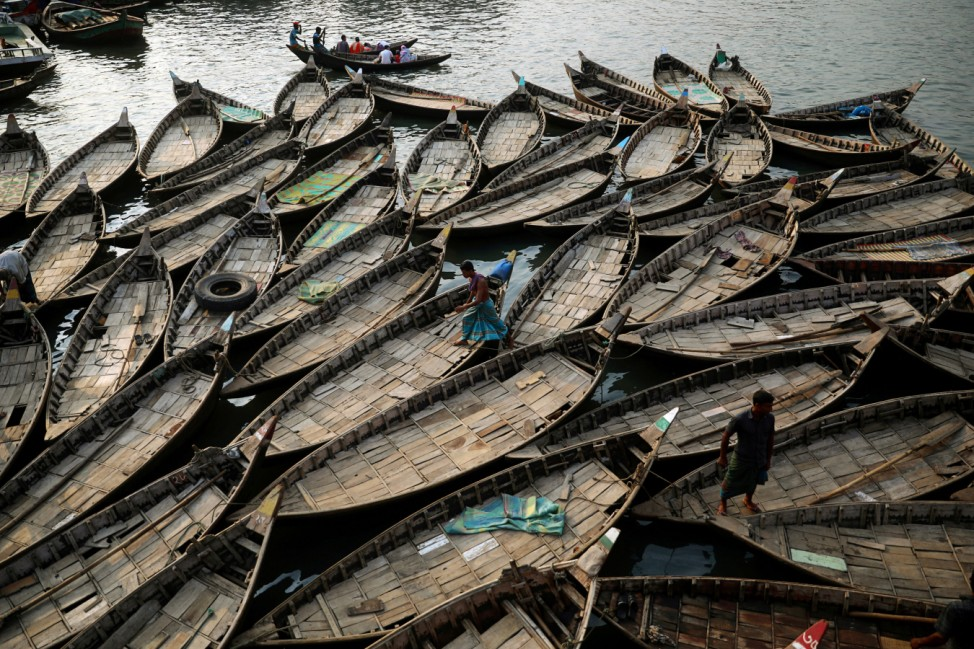 Boats are anchored at the bank of the river Buriganga which are used to carry passengers crossing the river in Dhaka