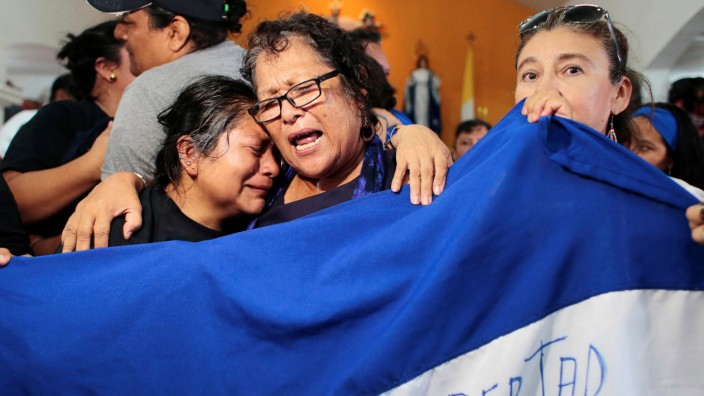 Women cry during a religious service for 56 political prisoners who were released under a new law that frees people who were arrested in recent protests against Nicaraguan President Daniel Ortega's government, in Masaya