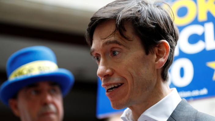 PM hopeful RoryStewart emerges from TV studios in Westminster, London