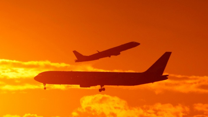 FILE PHOTO: Passenger planes land and take off at Sydney airport