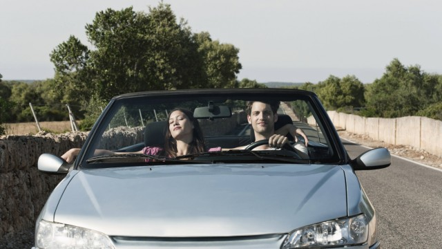 Spain Majorca Young couple travelling in cabriolet car model released PUBLICATIONxINxGERxSUIxAUTxH