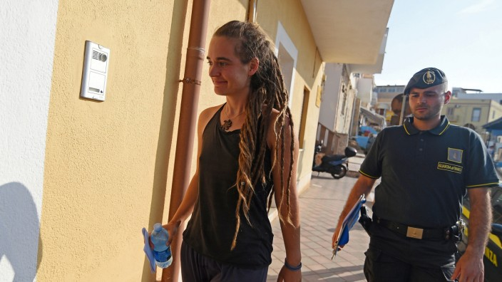 Carola Rackete, the 31-year-old Sea-Watch 3 captain is seen arriving at the Finance police headquarters in Lampedusa
