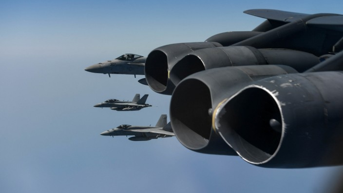 U.S. Navy F-18 Hornets are seen off the wing of a U.S. Air Force B-52H Stratofortress assigned to the 20th Expeditionary Bomb Squadron, part of the Bomber Task Force deployed to the region, while conducting joint exercises in Arabian Sea