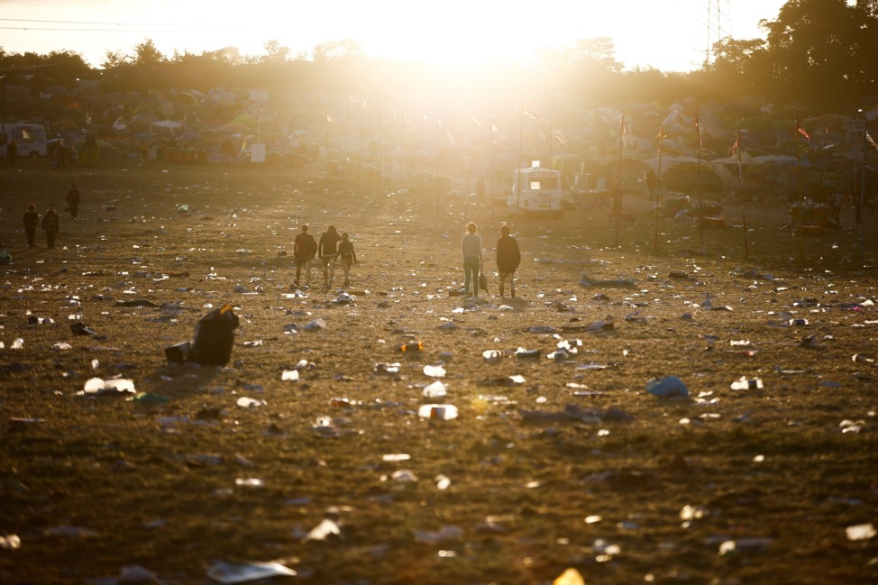 Festival goers are seen in the early hours of the morning following the end of Glastonbury Festival in Somerset