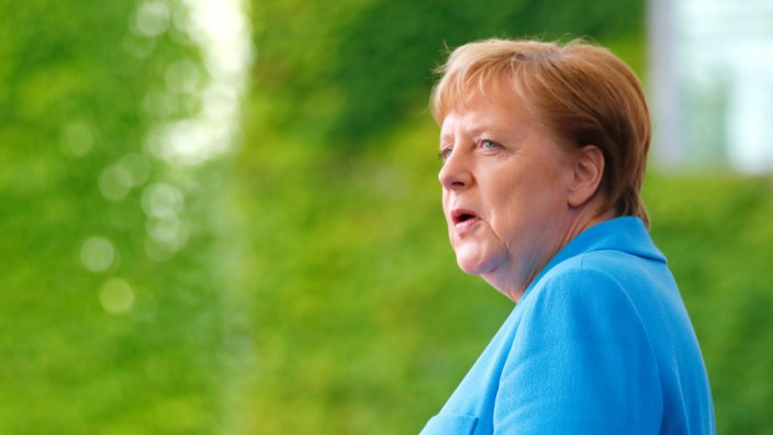 German Chancellor Angela Merkel welcomes Ireland's President Michael D. Higgins at the Chancellery in Berlin