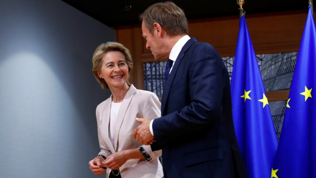 German Defense Minister von der Leyen poses with EU Council President Tusk in Brussels