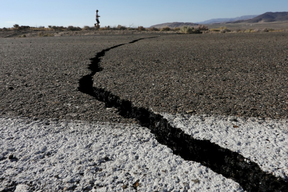 Fissures that opened up under a highway during a powerful earthquake that struck Southern California are seen near the city of Ridgecrest
