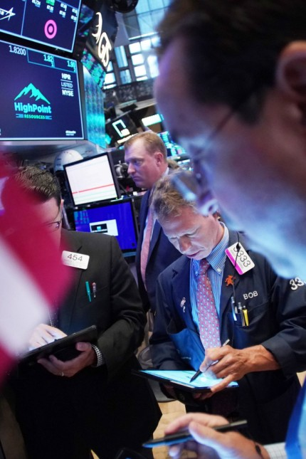 Traders work on the floor of the NYSE at the opening bell at the New York Stock Exchange on Wall Str