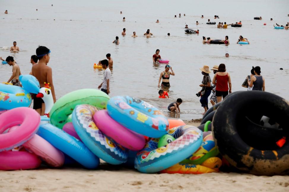 People play on the Do Son beach in Hai Phong city