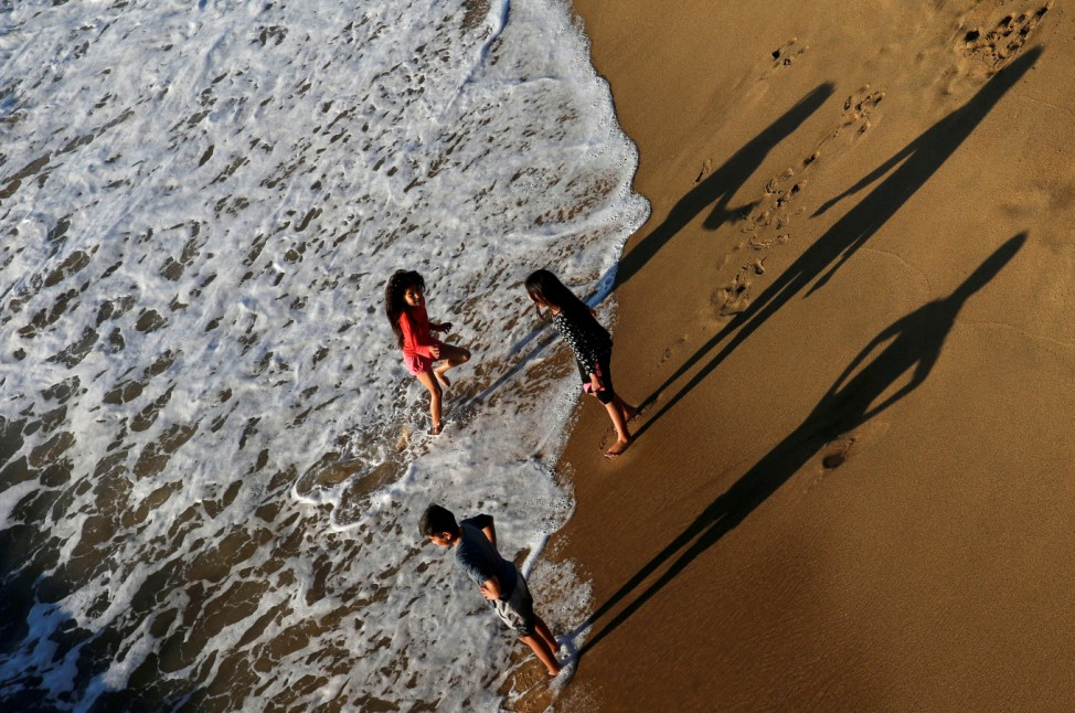 Children enjoy on a beach in the city of Vina del Mar