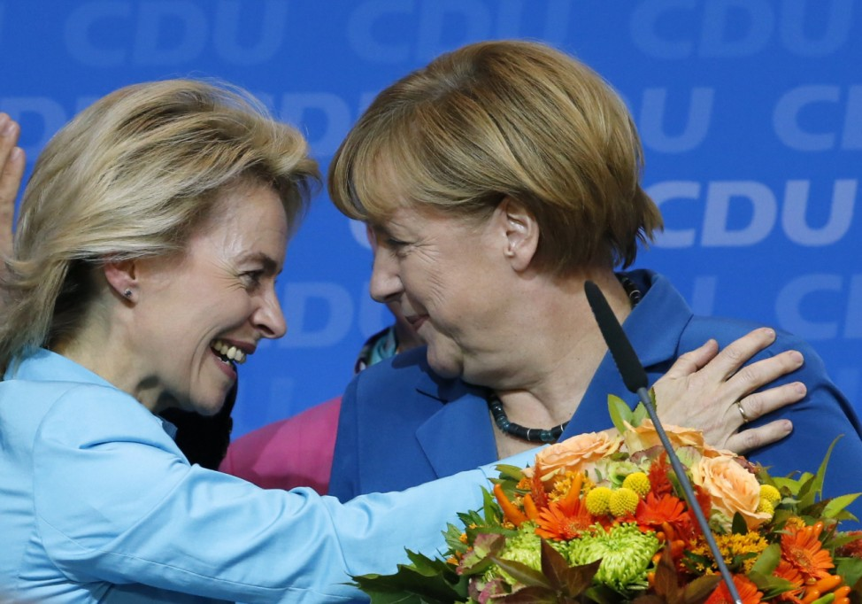 German Chancellor Merkel is congratulated by German Labour Minister Von der Leyen after first exit polls in German general election at the CDU party headquarters in Berlin