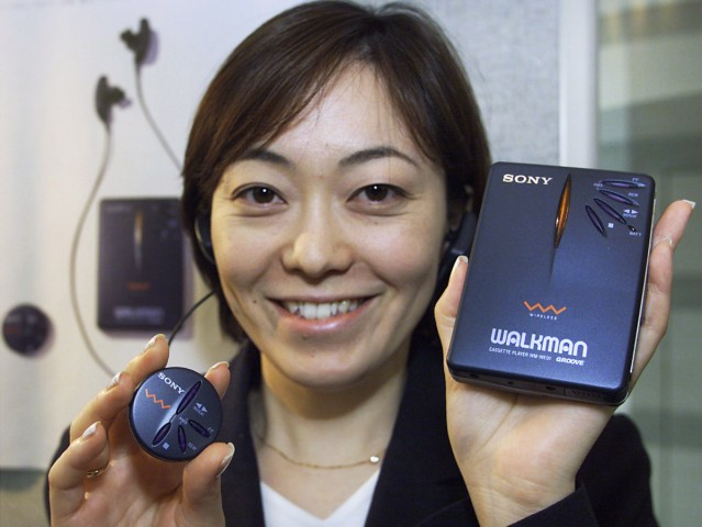 SONY STAFF SHOWS OFF ITS ANNIVERSARY MODEL WIRELESS WALKMAN IN TOKYO