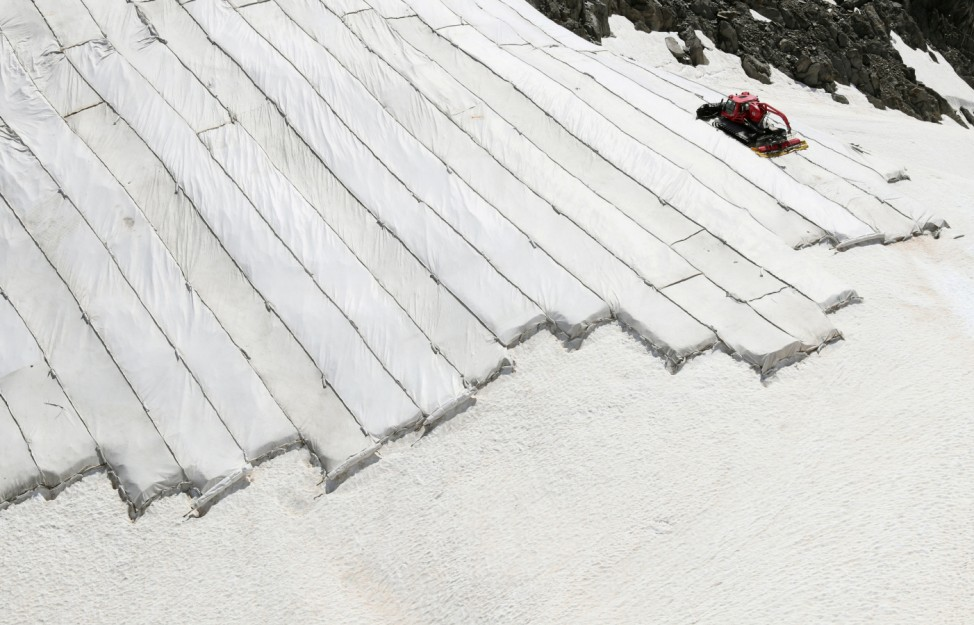 Parts of the Gurschengletscher glacier are covered with tarps in Andermatt