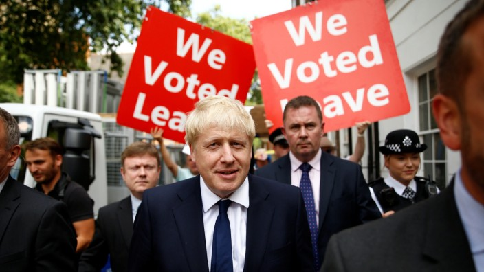 Boris Johnson leaves his office in London