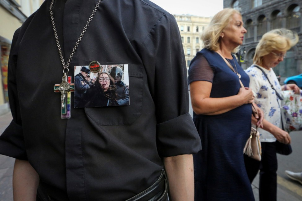 A supporter of LGBT community attends a rally after a murder of Elena Grigoryeva, activist for LGBT rights, in Saint Petersburg