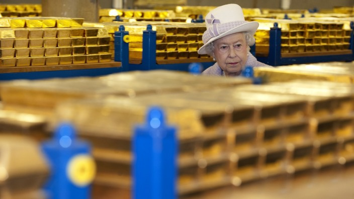 Britain's Queen Elizabeth tours a gold vault during a visit to the Bank of England in the City of London