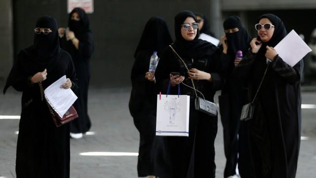 FILE PHOTO: Saudi students walk at the exhibition to guide job seekers at Glowork Women's Career Fair in Riyadh