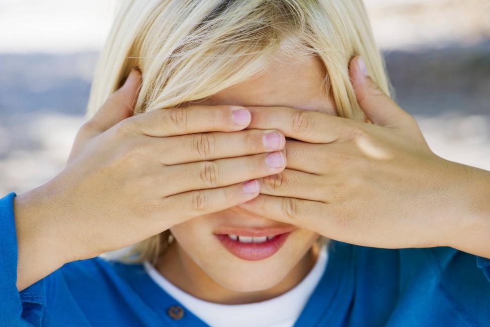 Boy covering eyes with hands PUBLICATIONxINxGERxSUIxAUTxONLY Copyright FrédéricxCirou B94884919