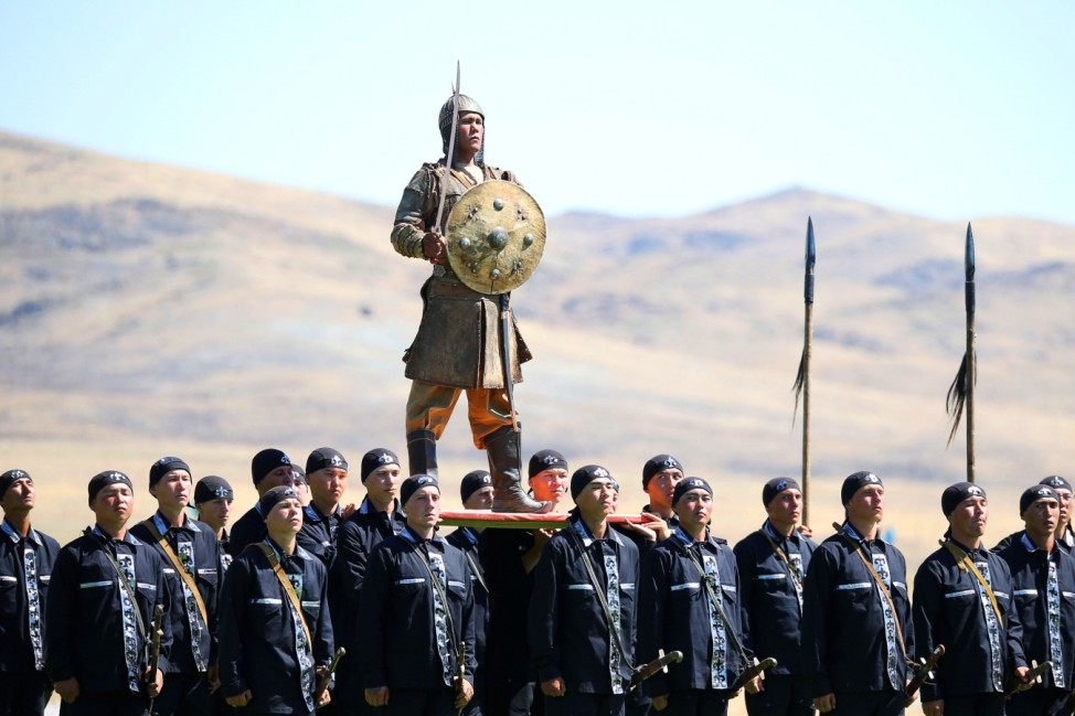 Kazakh servicemen attend a ceremony opening the International Army Games at a military base in Zhambyl region