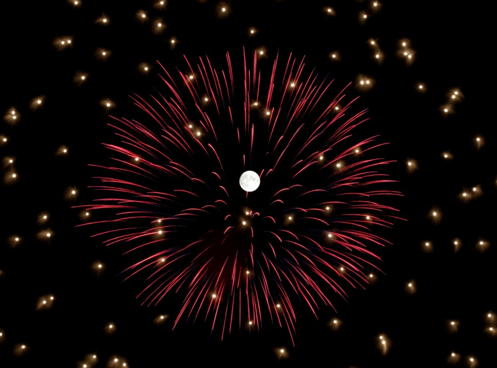 Fireworks explode in front of the full moon during celebrations marking the feast of the Assumption of Our Lady in Mosta