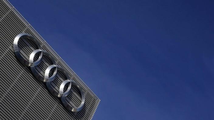 An Audi logo is seen at a car dealer in Eching near Munich