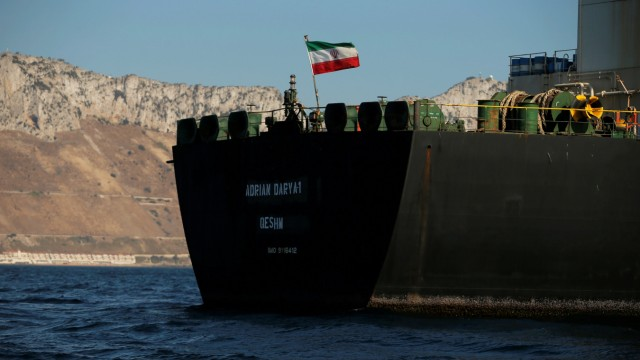 The Iranian flag flies at Iranian oil tanker Adrian Darya 1, before being named as Grace 1, as it sits anchored after the Supreme Court of the British territory lifted its detention order, in the Strait of Gibraltar