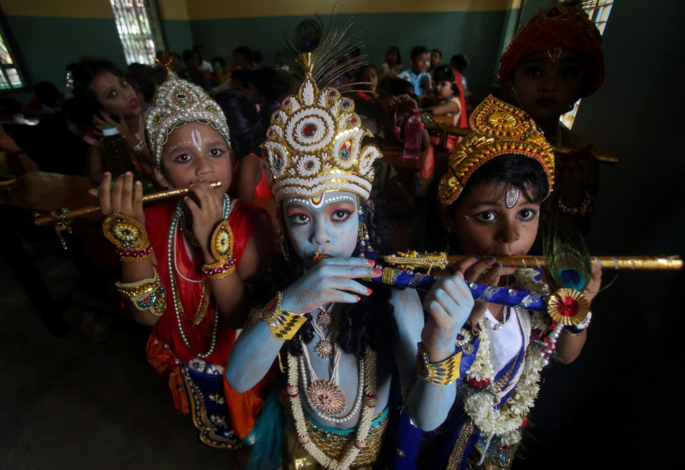 Children dressed up as Hindu Lord Krishna pose during Janmashtami festival celebrations inside a school in Agartala