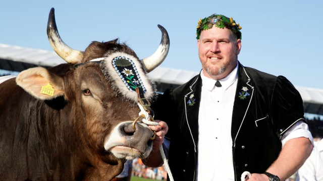 Winner Christian Stucki poses with bull Kolin during the ESAF-Federal Alpine Wrestling Festival (Eidgenoessisches Schwing- und Aelplerfest) in Zug