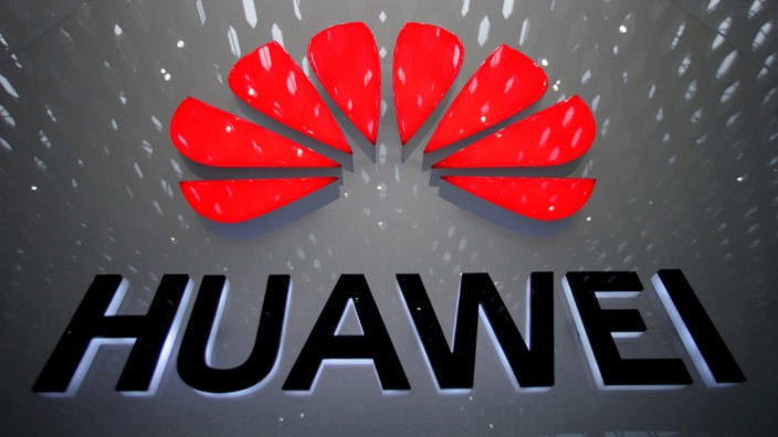 FILE PHOTO: A Huawei company logo is pictured at the Shenzhen International Airport in Shenzhen, China