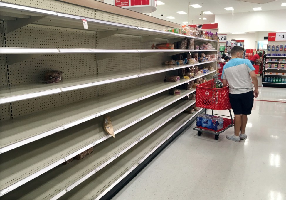 Shoppers find empty bread shelves at a store ahead of the arrival of Hurricane Dorian in Kissimmee