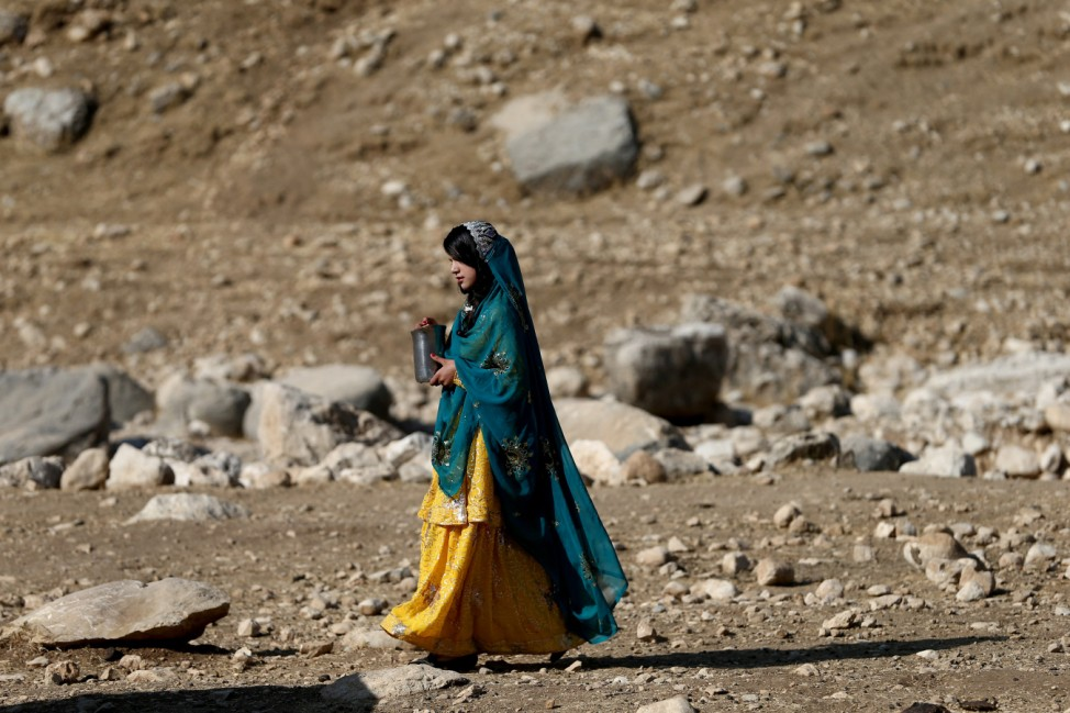 An Iranian woman walks during the traditional wedding of Sahar and Zal Sahbazi, Iranian nomad bride and groom, at Bazoft town in Chaharmahal and Bakhtiari Province