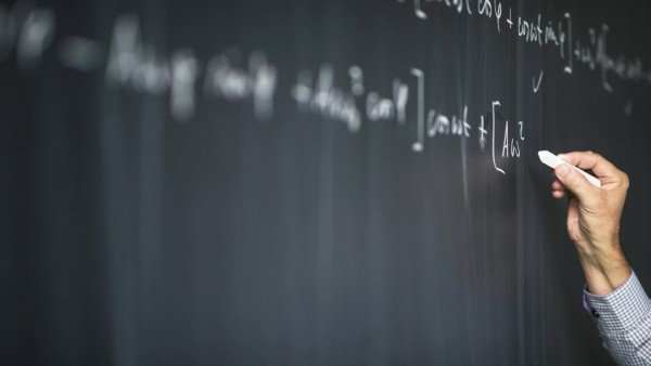 Math teacher drawing fuction graph on a blackboard during mathclass motion blurred image model r