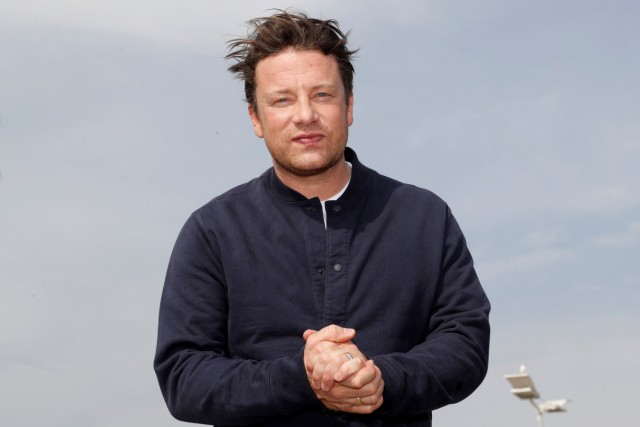 FILE PHOTO: Chef Jamie Oliver poses during a photocall at the annual MIPCOM television programme market in Cannes