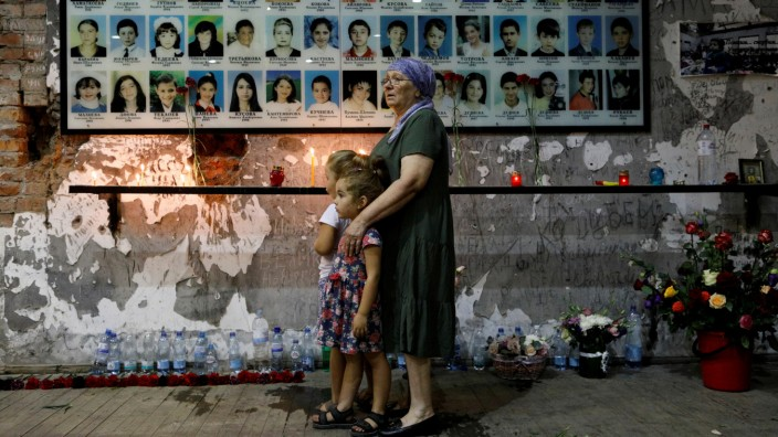 People attend a memorial ceremony marking the anniversary of the school siege in Beslan