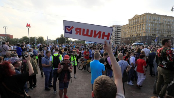 People attend a rally to demand free elections in Moscow
