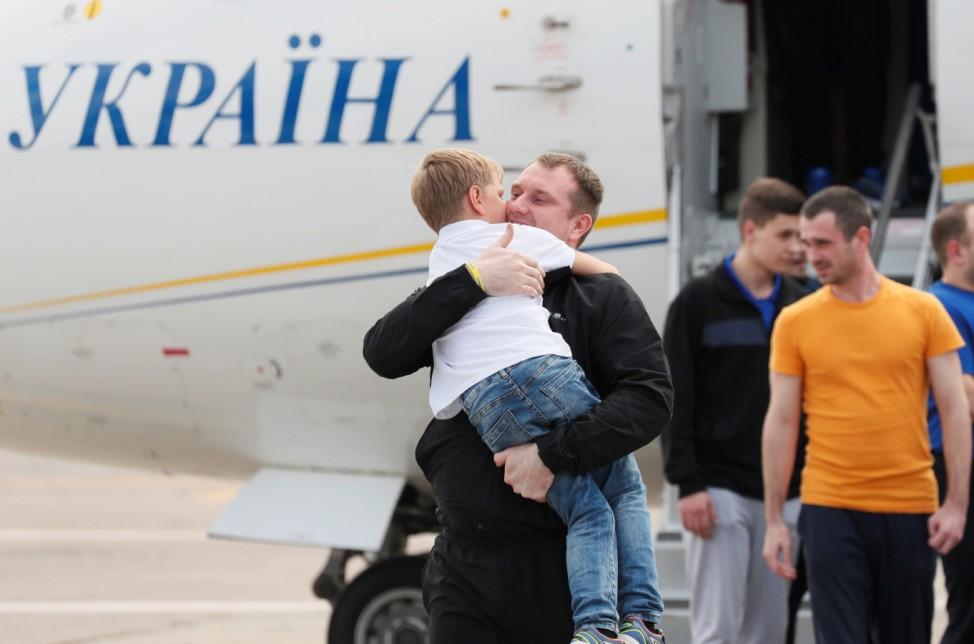 A recentlyexchanged Ukrainianprisoner embraces his relative upon arrival in Kiev after Russia-Ukraine prisoner swap, at Borispil International Airport, outside Kiev