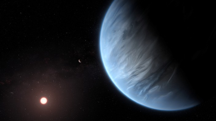 An artist's impression shows the planet K2-18b, its host star and an accompanying planet