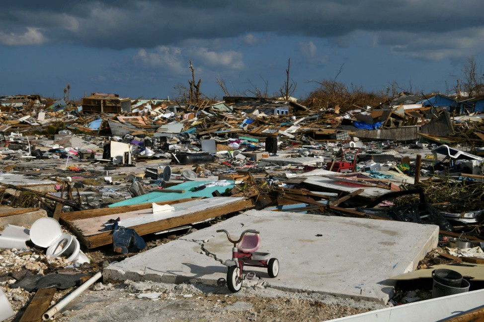 FILE PHOTO: A child's bicycle is seen in a destroyed neighborhood in the wake of Hurricane Dorian in Marsh Harbour