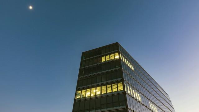 Germany Stuttgart lighted windows at modern office building at blue hour PUBLICATIONxINxGERxSUIxAU