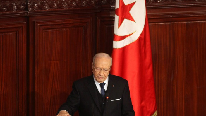 FILE PHOTO: Tunisia's President Beji Caid Essebsi takes the oath of office at the constituent assembly in Tunis