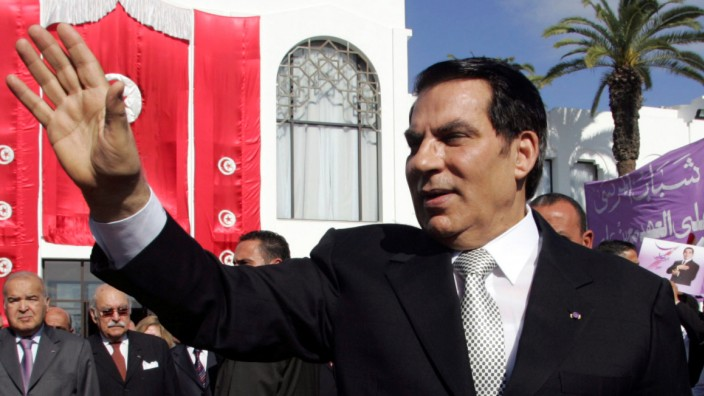 FILE PHOTO: Tunisia's President Zine al-Abidine Ben Ali waves to supporters after he took the oath at the national assembly in Tunis