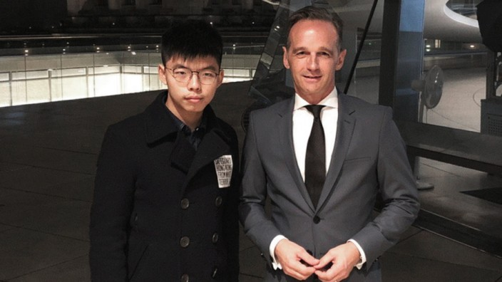 Hong Kong's activist Wong poses with German Foreign Minister Maas on top of Bundestag in Berlin