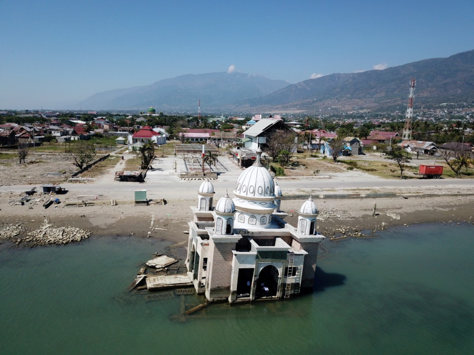 Aerial view of the damage caused by an earthquake and tsunami nearly one year ago over Sulawesi