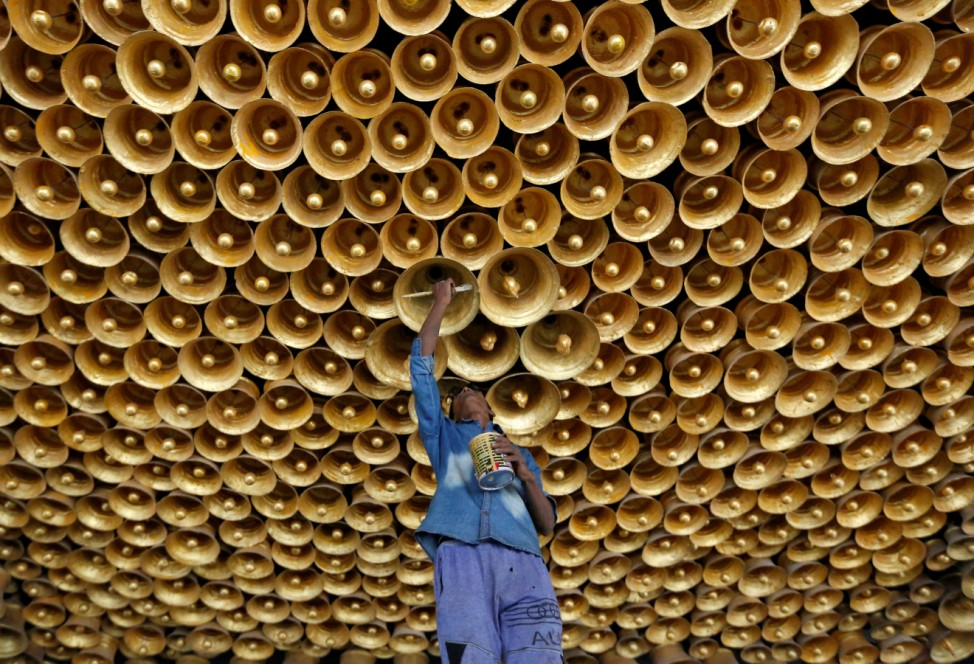 An artisan applies finishing touches to a decorative ceiling of a pandal during preparations for the upcoming Hindu festival of Durga Puja in Kolkata