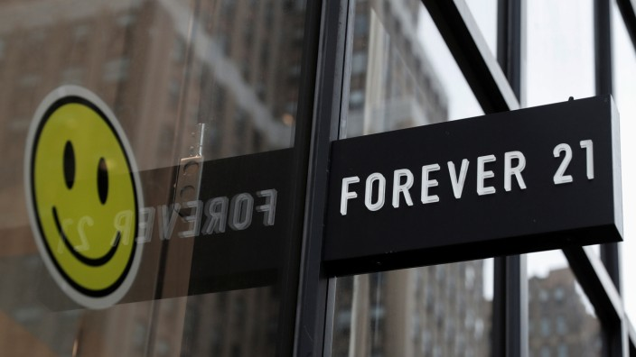 The sign for clothing retailer Forever 21 is seen outside the store in New York City