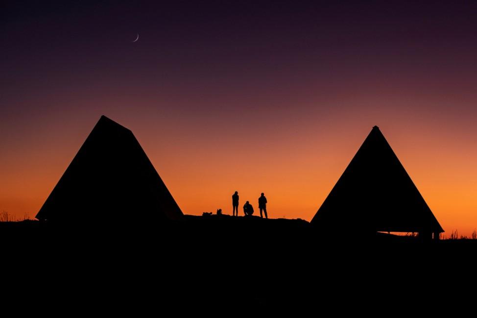 Tourists watch the sunset in the Caucasus mountains outside Krasnaya Polyana near Sochi