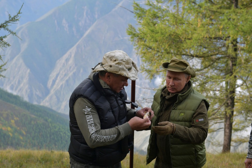 Russian President Putin and Defence Minister Shoigu are  seen during a holiday in the Siberian taiga