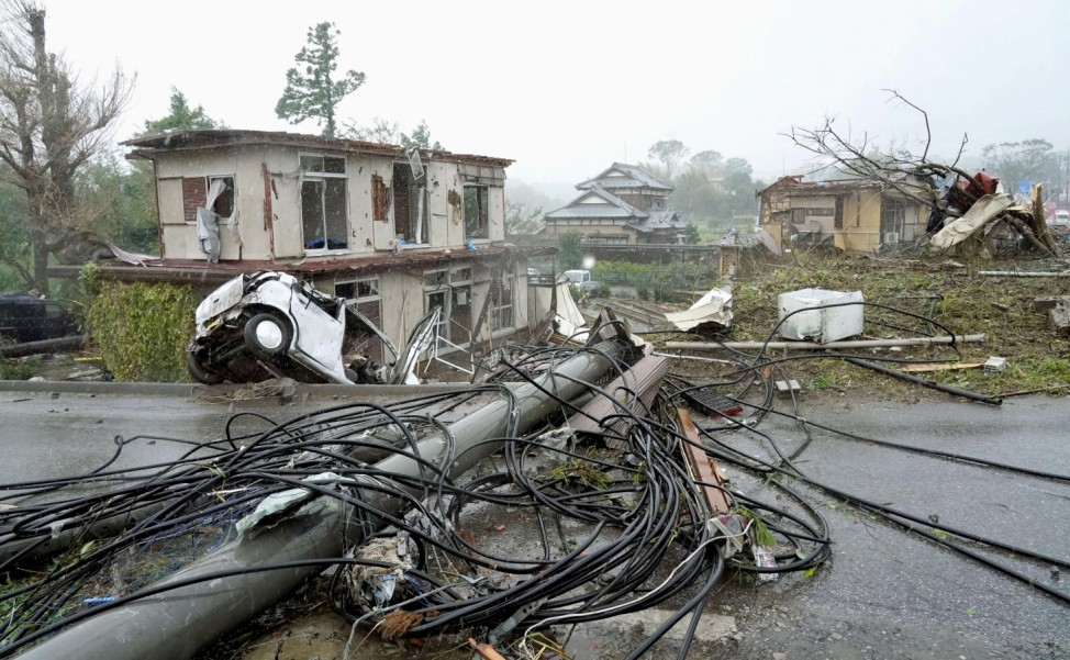 Destroyed houses, cars and power poles, which according to local media were believed to be caused by a tornado, are seen as Typhoon Hagibis approaches the Tokyo area in Ichihara